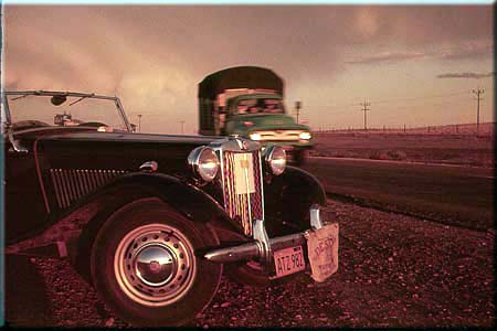 Photo: True color sunrise pinkout of MG TD and a passing truck, west of Albuquerque