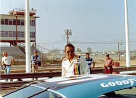 Thumbnail: David Pearson wearing sunglasses at an IROC, RIR